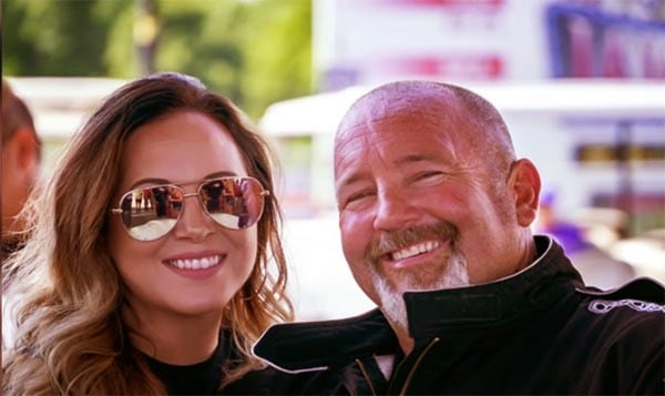 Image of an American drag racer, Chuck Seitsinger and his girlfriend