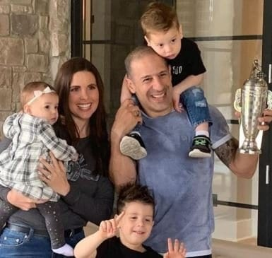 Image of one of the best car tv shows, Garage Squad, Lauren Bohlander with her family