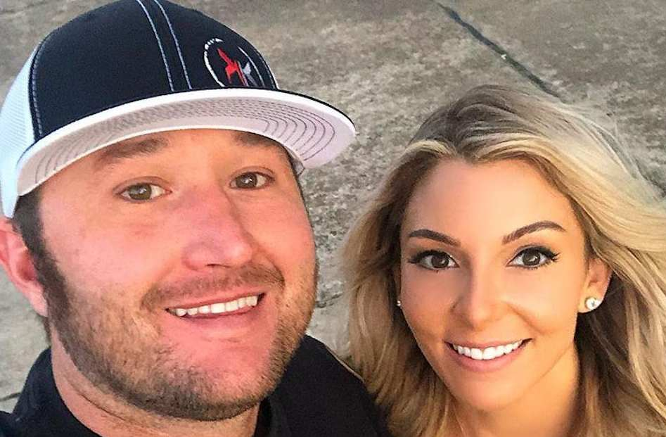 Image of a professional American female drag racer, Lizzy Musi with her boyfriend